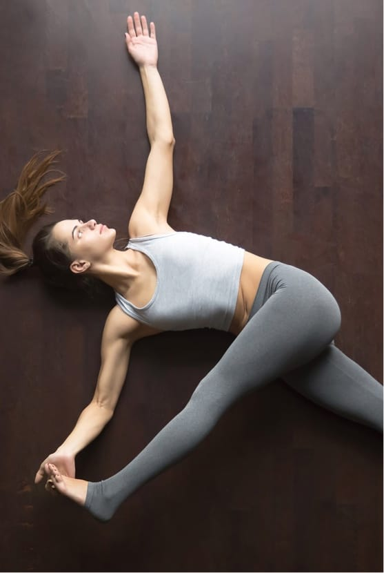 Woman doing lower back stretch